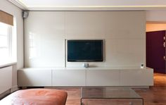 Discrete media centre in cream with integrated plasma screen and concealed storage.