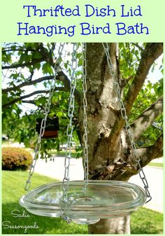 Repurpose a glass casserole dish lid from the thrift store into a perfect, simple, easy-to-clean hanging bird bath! No glass drilling required- just some chain and easy to find hardware from the home improvement store. Perfect addition to your yard decor and the birds will love it!