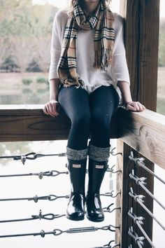 White large knit sweater, Burberry plaid scarf, black leggings, and short black Hunters.