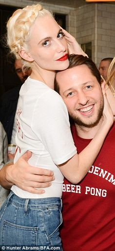 Man of the hour: Editor and author Derek Blasberg was snapped cozying up to both teammate ...