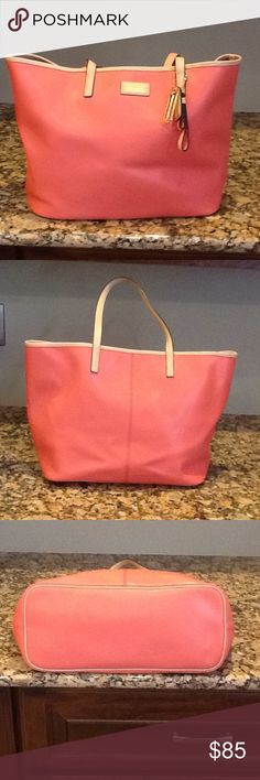Coach Tote Bag  Salmon Color Coach Bag with Tan Trim.  Large Tote Bag with Three Pockets Inside, One with a Zipper.  Has a few light pens marks, Other Wise in Great Condition. Coach Bags Totes