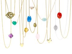 Tiny necklaces with bright colored precious stones...