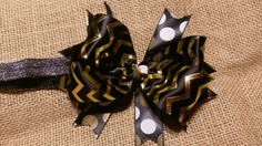 Shiny Black and Gold Chevron print headband/hair bow that is perfect for that black and gold foil onesie!  So festive and eye catching, this hair bow is available as a headband and hair bow - no extra charge for adding headband.    NOTE:  I would love to create your own customized hair bow or headband for any outfit you want matched.  Just message me!    NOTE:  Please do not leave child unattended with hair bow as it may contain small pieces that could post harmful to little ones.    Hair…