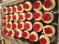 Chocolate Cupcakes with French vanilla buttercream frosting topped with a buttercream rose
