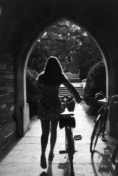 Princeton student photographed collecting her bicycle (1969)