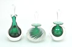 Emerald glass perfume bottles.