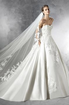 Princess style mikado silk wedding dress. Sweetheart bodice with narrow mikado silk belt at the waist. Pronovias 2016 Wedding Dress Collection