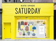 The bright, bold yellow hue of this store front creates attention and draws the eye towards the store making it the emphasis of the street block. creative signage, retail