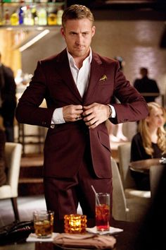 Only Ryan Gosling could pull off a maroon suit. so tasteful.