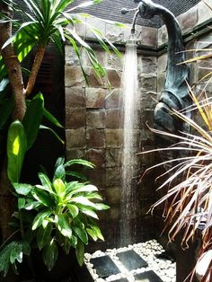 This exotic outdoor shower is located in a Bali resort. We're ready to vacation there asap!