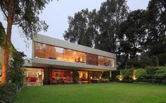 """Concrete and Steel """"House H"""" in Lima Built Around a Sunken Garden - http://freshome.com/2015/03/10/concrete-and-steel-house-h-in-lima-built-around-a-sunken-garden/"""