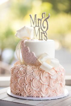 With pink frosting and a crystalcake topper, it fit the wedding theme perfectly! | A Beautiful Blush Wedding | Kate Aspen | #weddingcake #blushcake