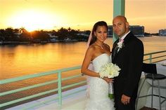 Lazaro Sopena poses with Hann Dinh on their wedding day in Miami Beach, Florida, in this July 2, 2011 handout photo. Sopena opted to take his wife's last name only to be accused of fraud by the state's Department of Motor Vehicles.   Way to perpetuate gender bias, Florida.