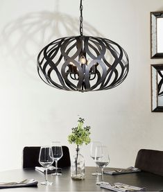 Bronze metalwork cut-out design with interior chandeliers- choose from two sizes. Cage Pendant Light, Cage Light, Ceiling Light Fixtures, Ceiling Lights, Light Bulb Wattage, Bronze Chandelier, Cut Out Design, Bronze Finish, Living Spaces