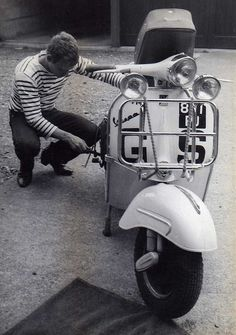 Wrenching on the GS in a nice pair of Beatle boots and a stripey shirt.