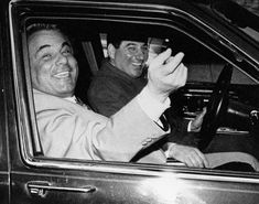 """John Gotti, the """"Teflon Don,"""" is all smiles after he was acquitted on charges of conspiracy and assault in the 1986 shooting of a carpenter's union official. Gotti and his driver arrive at the Ravenite Social Club on Mulberry St. in Feb 1990."""