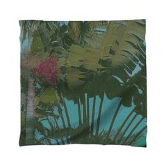 Tropical Tapestry Scarf By mae-glenn $48.00  This original, faux antique tropical tapestry began as an original photograph of a white bird of paradise plant. The fan shaped dark green leaves spread out against the aqua blue sky, some of them brushed by sunlight near a cluster of orange red seeds. The design has an overall canvas texture.