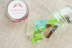 Sea glass candy favors double as placecards with guests' names on them