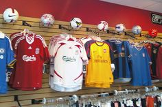Sense-of-Place Sport-Specific Sense of Place With Ring Hook Visual MerchandisingSport-Specific Sense of Place With Ring Hook Visual Merchandising Store Layout, Soccer Store, Retail Store Design, Store Fixtures, Slat Wall, Soccer World, Sense Of Place, Some Ideas, Visual Merchandising