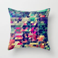 Want to start looking into getting a series of similar geometric cushions - Atym Throw Pillow by Spires - $20.00