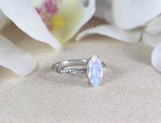 Exclusive to Benati. 14k white gold  Moonstone Engagement ring, Marquise cut natural moonstone and diamond ring.  Inspired by nature. Timeless Engagement Ring, Bridal Earrings, Bridal Jewelry, Rainbow Moonstone Ring, Alternative Engagement Rings, Marquise Cut, Black Rings, Wedding Ring Bands, Vintage Rings