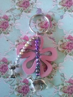 Keyring with big flower and greyhound.