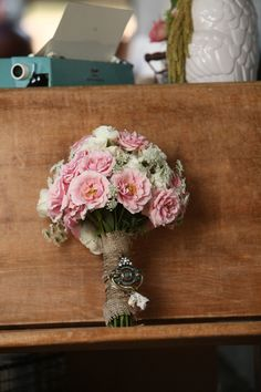 Pretty pink bouquet wrapped in burlap. Photo by Jesse Reich Photography. www.wedsociety.com #wedding #burlap #bouquet