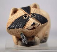 "This raccoon is from the Artesania Rinconada #60 classic collection. All Rinconada fingurines are hand carved and painted in Uruguay. This raccoon measures about 2"" tall and 3.75"" long. 17 ES 1"