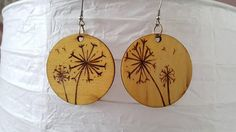 Check out this item in my Etsy shop https://www.etsy.com/uk/listing/557525850/dandelion-wood-earrings-wood-burn