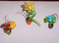 Google Image Result for http://www.quilledcreations.com/quillinggallery/data/522/medium/Quilled_pots.jpg