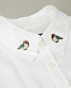 Bird pins on the collar