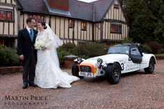 A Caterham race car, used by the groom to drive his bride from the church to the reception at Cain Manor. Wedding photography by Martin Price Photography. www.martinpricephotography.co.uk
