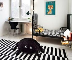 Boy's room with playful, modern decor in black and white.