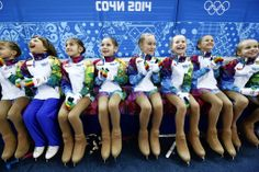 so cute...!! Flower girls wait on the sidelines before the pairs short program of the figure skating event at Iceberg Palace. — Barbara Walton, EPA, Feb....