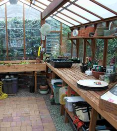 I think wooden work surfaces in greenhouses are the best way to go. Makes me want to get my hands all covered in peat moss.