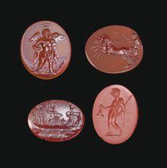 FOUR ROMAN RINGSTONES CIRCA 1ST-3RD CENTURY A.D.