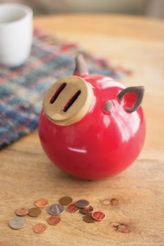 Kalalou Ceramic Piggy Bank - Store your loose change with this adorable red piggy. Its spherical body is made of thick ceramic and makes this lil' guy the perfect shelf sitter.