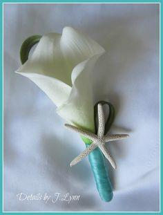 Tropical Beach Boutonniere / Bout - Calla Lily, Grass and Star Fish - Wedding. $9.00, via Etsy. I ordered this item and it is great! Looks real and feels it too!!! We decided to go with all real touch flowers and are saving hundreds!