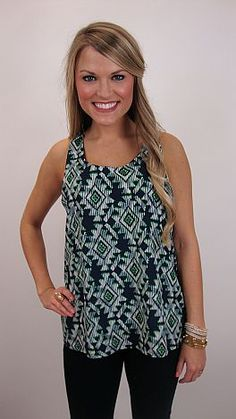 As this tank proves, tribal prints don't always have to be over-the-top! The classic colors in this tank (navy and kelly green) lend a more subdued look to an otherwise trendy print. The back has a unique twist... literally! Instead of having a conventional racer back, the back is looped around the shoulder straps for a little bit of dimension! Pair it with our gorgeous green blazer for a outfit that's totally put together!     $36