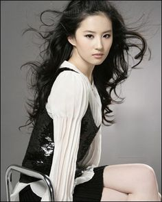 """Liu_YiFei   also known as Crystal Liu, is a Chinese actress, model and singer. Her legal name is Liu Ximeizi. In conjunction with her acting career, Liu obtained a recording contract with Sony Music Entertainment Japan in August 2005. She has started studying singing and dancing in Japan since then.[7] She released her first single """"Mayonaka no Door"""" with Sony Music on July 19, 2006.    www.songdew.com"""