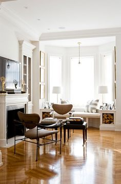 classic white with contemporary touches.  love the beautiful bay window seat, chevron floors, and natural light.  Sharon Mimran.