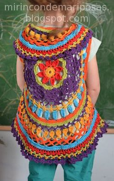 This is like a big doily with slots for armholes. The blog is Spanish - the pattern is posted, just needs to be translated.