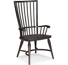 Arm Chair        * Collection : Cinnamon Hill      * 42729-846        Starting At $449*    What's old feels fresh again. The modern, graphic look of the tall Arm and Side Chairs was inspired by the antique Windsor chair, dating to late-1600s England. Typical features include the comfortable, carved saddle seat, graceful bentwood arms and crescent stretcher. Today's trendy Licorice finish (shown) originally helped disguise variances in woods required for both strength and flexibility. Our…
