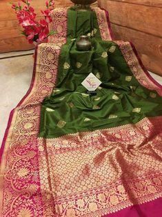This is a handpicked katan banarasi saree with beautiful golden zari work in the pallu and border. With butta work on the seaweed color body, it is a must buy this summer wedding season. Kanjivaram Sarees Silk, Banarsi Saree, Indian Silk Sarees, Kanjipuram Saree, Latest Saree Blouse, Pattu Saree Blouse Designs, Desiner Sarees, South Silk Sarees, Rangoli Designs Latest