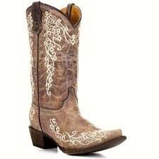 This Corral youth Crater Bone Embroidered Western Boot is a smaller version of one of the best selling ladies Corral boots. It features a whimsical floral embroidery design in cream on the vamp and sh