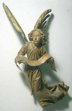 Nuremberg vers 1490-1500 Ange volant tenant un phylactère Tilleul autrefois polychromé, décapé excepté sur les ailes (dorure ancienne avec reprise) H. : 1 m.
