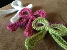 Crochet Flower Applique Ribbon Bow Motif By jkwdesigns - Free Crochet Pattern - (ravelry) - Appliques Au Crochet, Crochet Bow Pattern, Crochet Motifs, Crochet Flower Patterns, Crochet Stitches, Free Pattern, Crochet Puff Flower, Crochet Bows, Diy Crochet