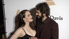 Loved up! Kat Dennings and boyfriend Josh Groban arrive at pre-Grammy gala.  Kat stunned in a floor-length black gown featuring a thigh-high split while Josh went in a chic brown and black-patterned suit.