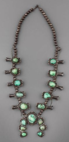 American Indian Art:Jewelry and Silverwork, A NAVAJO SILVER AND TURQUOISE SQUASH BLOSSOM NECKLACE