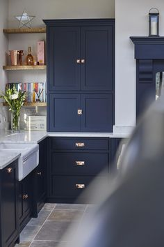 The distinctively dark cupboards of our Guildford kitchen are painted in Little Greene's Basalt to provide contrast to the copper, quartz and reclaimed wood elements featured throughout this stunning kitchen. Dark Blue Kitchen Cabinets, Dark Blue Kitchens, Painting Kitchen Cabinets, Kitchen Paint, Home Decor Kitchen, Kitchen Interior, Painted Kitchen Cupboards, Kitchen Ideas, Soapstone Kitchen